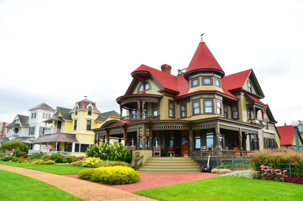 "I think we've paid for a portion of security-software mogul Peter Norton's Oak Bluffs. home.  The Queen Anne style distinguishes it from neighboring cottage homes. Inscriptions in various languages make tongue-in-check statements such as ""Peter's Summer House"" in Russian and ""If you can read this you speak Greek, in, you guessed it, Greek."