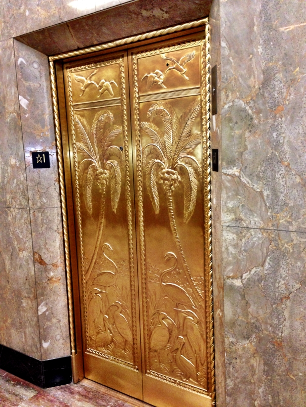 Bronze bas-relief elevator doors featuring Florida motifs are a highlight of the 1939, post-Depression Alfred Dupont building in downtown Miami.