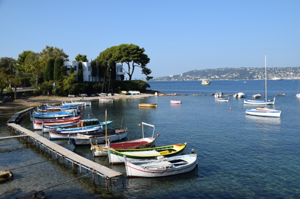 Modest local boats, near elegant villas and gardens, share fantastic views along the Cote d'Azur.