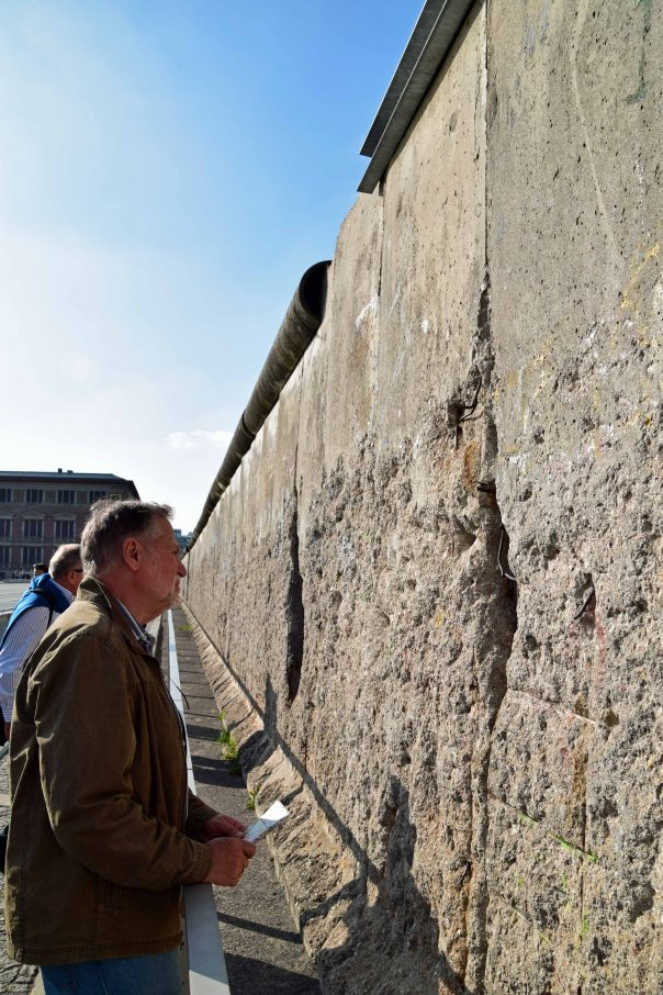 Visiting what's left of the Berlin Wall.  Without the barbed wire, attack dogs, and guards with an easy trigger finger . . . .
