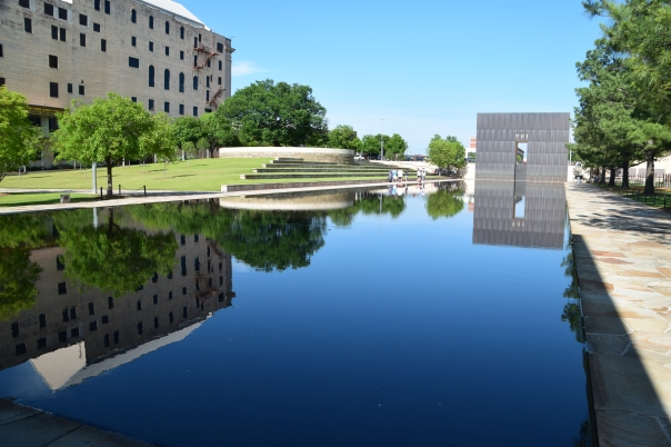 """At the Oklahoma City National Memorial, two large """"walls"""" frame the reflecting pool.  The one shown here says 9:01 and it's twin, 9:03.  the bomb was at 9:02, at the location of the pool."""