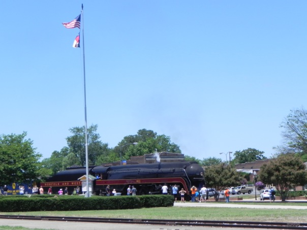 Crowds gather to watch the 611 roll to a stop.