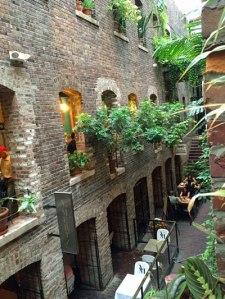 Galleries and restaurants tucked between buildings in Omaha's Old Market district.